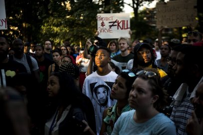 A demonstrator wearing a Trayvon Martin T-shirt stands with others in Washington D.C. to express solidarity with protesters in Ferguson, Mo.